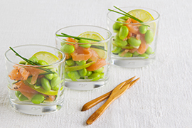 Small glasses with edamame soybeans, salmon and courgettes
