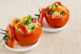 Oven baked tomatoes stuffed with veggie cous-cous