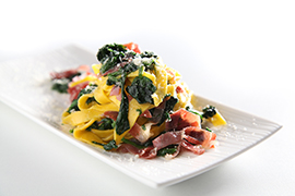 Tagliatelle with Parma ham, spinach and Parmesan flakes