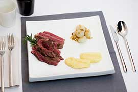 Sliced fillet of argentine beef with acacia honey-glazed borrettane onions, raisins and mashed potatoes in drops