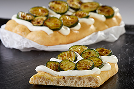 Focaccia with stracchino cream and grilled courgettes